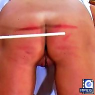 Dzejisis has been extra naughty and is placed in a guillotine to receive her caning