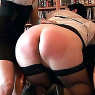 Lazy girl relentlessly spanked by beautiful blonde bitch. Hot quivering buttocks on fire